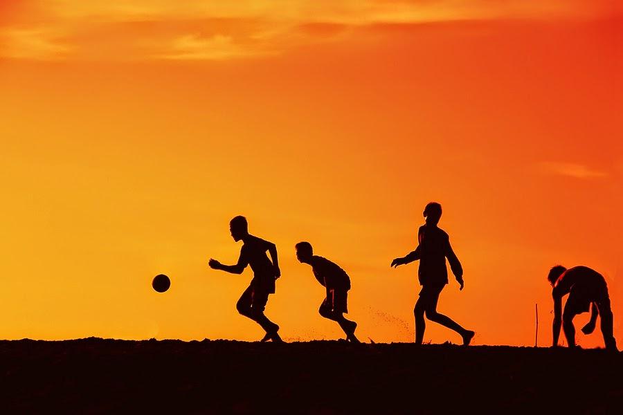 Image result for soccer silhouette sunset